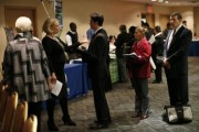 Job seekers wait to meet with employers at a career fair in New York City, October 24, 2012.