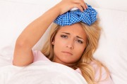 woman with ice pack against headache