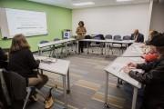 A recruiter speaks to job seekers