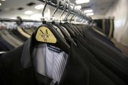 Suits hang on a rack at a Men's Wearhouse store in Pasadena, California June 25, 2013.