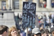 A protester holds a placard during a rally in Trafalgar Square in central London May 1, 2013. Credit: Reuters/Toby Melville