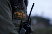 U.S. Customs and Border Patrol agent David Faatoalia wears a radio on his chest as he patrols along the international border between Mexico and the United States near San Diego, California, March 26,