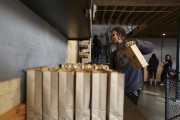 Ross Lesslie weighs bags of coffee for wholesale packaging and shipping at Sightglass, a coffee bar and roastery, in San Francisco, California May 8, 2013. The new generation of upscale coffee shops a