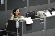 A broker yawns during trading at a stock exchange