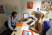 Christopher (L), a 24-year-old unemployed Frenchman, talks with a career adviser at a local agency for employment as he looks for a job in Marseille June 17, 2013. Once a month Christopher meets with