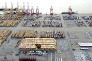 Cars and containers are pictured at a shipping terminal in the harbour of the German northern town of Bremerhaven, late October 8, 2012. Credit: Reuters/Fabian Bimmer