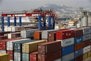 Containers are seen at Naples harbour July 13, 2013. Italy, a high-fashion Mecca and home to a culture obsessed with elegant appearances, was the top EU importer of low-cost Chinese clothing a decade
