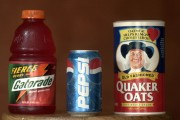 A can of Pepsi is shown in front of a box of Quaker Oats and a bottle of Gatorade