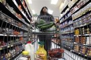 A shopper walks down an aisle in a newly opened Walmart Neighborhood Market in Chicago September 21, 2011.