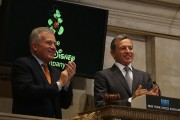 Disney CEO Bob Iger (R) rings the Closing Bell at the New York Stock Exchange