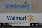 The Wal-Mart company logo is seen outside a Wal-Mart Stores Inc company distribution center in Bentonville, Arkansas June 6, 2013.