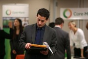 Job Seekers Apply For Open Positions At Career Fair