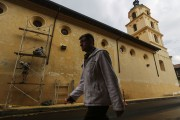 A man walks past a church on October 1, 2016 in Bogota, Colombia.
