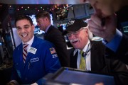 Dow Climbs Above 18,000 For First Time On Strong GDP Figures