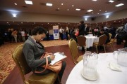 A woman fills out a job application as she attends a job fair in New York, June 11, 2013.