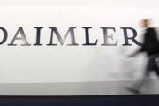 A shareholder arrives to a Daimler AG annual shareholder meeting in Berlin, April 4, 2012.