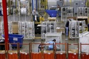 Workers assemble built-in appliances at the Whirlpool manufacturing plant in Cleveland, Tennessee