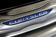 The Chrysler logo is shown on a new Chrysler 200 on the showroom at the Massey-Yardley Chrysler, Dodge, Jeep and Ram automobile dealership in Plantation, Florida October 8, 2013.
