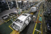 Employees assemble cars at a production line of Dongfeng Peugeot Citroen Automobile factory in Wuhan, Hubei province, February 13, 2014.